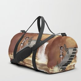 Cute girl dancing on a piano on the beach Duffle Bag