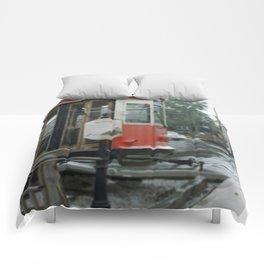 Train in z rain Comforters