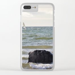 Windsurfer and black stone at gray sea Clear iPhone Case