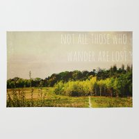 not all who wander are lost Area & Throw Rugs featuring not all those who wander are lost by Sybille Sterk