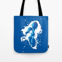 mega man Tote Bags featuring Mega Man Splattery Design by The Daily Robot