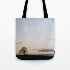 Tree on a hilltop above Matlock silhouetted at twilight. Derbyshire, UK. Tote Bag