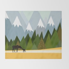 Woodland snowy mountain tops trees and mother moose and baby Throw Blanket