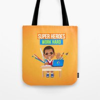 super heroes Tote Bags featuring Super Heroes Work Hard by youngmindz
