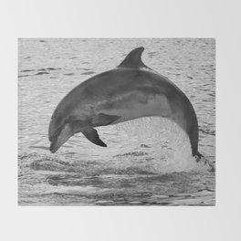Jumping wild bottlenose dolphin black and white Throw Blanket