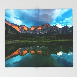 Burning sunset over the mountains at lake Fusine, Italy Throw Blanket