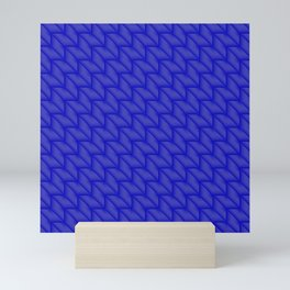 Tiled pattern of dark blue rhombuses and triangles in a zigzag. Mini Art Print