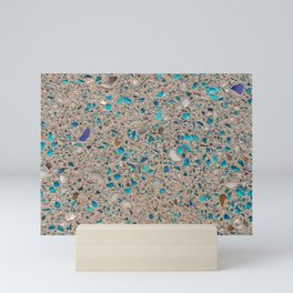 Colorful recycled glass for construction of concrete sidewalk Mini Art Print