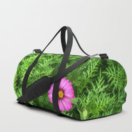 Top view of Yellow cosmos or Sulfur cosmos bush with a blooming pink Zinnia flower. Duffle Bag