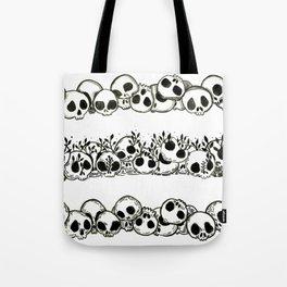 several piles of skulls Tote Bag