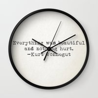 "vonnegut Wall Clocks featuring ""Everything was beautiful and nothing hurt."" -Kurt Vonnegut  by Typed Book Quotes"