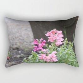 Flowers grow next to old mining equipment Rectangular Pillow