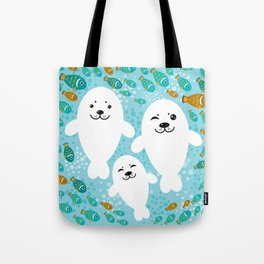 happy family of white seals and fish on a blue background. Tote Bag