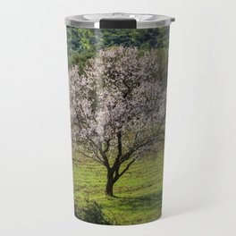An almond tree in flower in the Algarve countryside Travel Mug