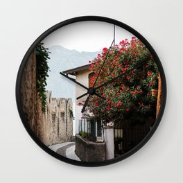 Street in Malcesine with a red flower tree | Italy Travel Photography | Lake Garda photo Wall Clock