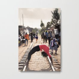 Africa Yoga Project. Irene in wheel on Kibera train tracks, Nairobi Kenya Metal Print