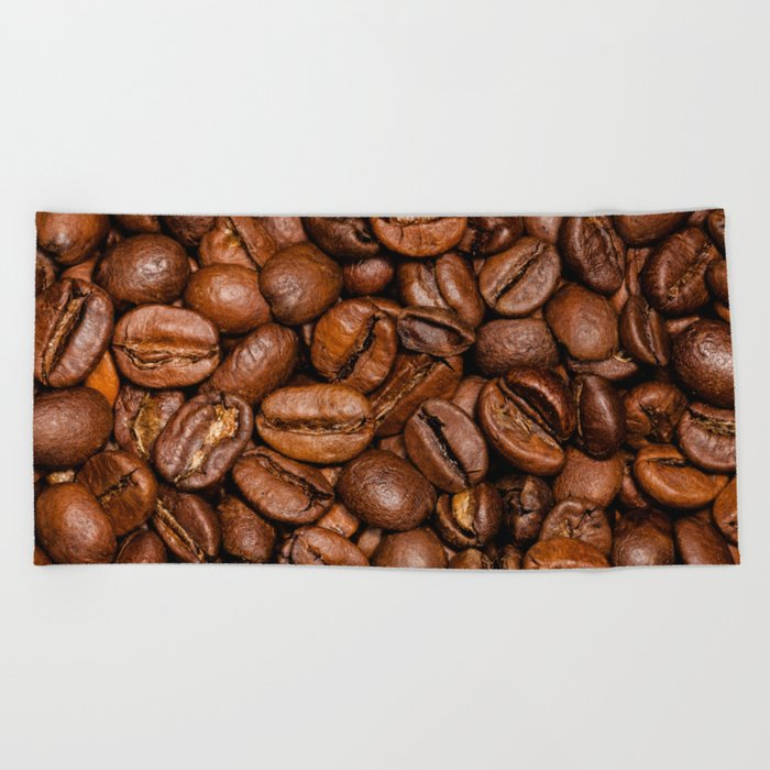 Shiny brown coffee beans Beach Towel