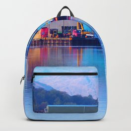Industrial reflection at mountains edge Backpack
