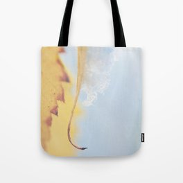 a snow covered leaf, as fall turns to winter. Tote Bag