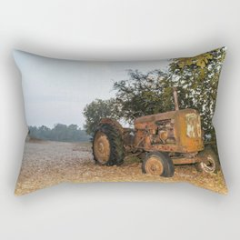 Old tractor on a pebble beach by a river Rectangular Pillow