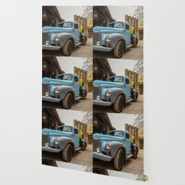 Historic blue-colored pickup parked in the streets of an historic Italian village Wallpaper
