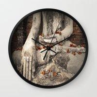 buddhism Wall Clocks featuring Buddha with flowers by Maria Heyens