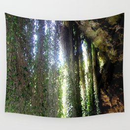 Vines camouflaging a sunken Cave Wall Tapestry