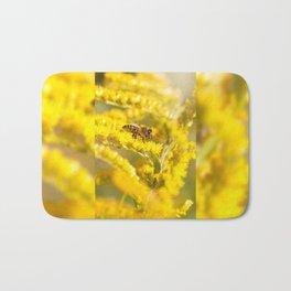 Bee sitting on Solidago virgaurea Bath Mat