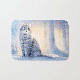 Cat in winter wonderland Bath Mat