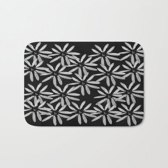 Tiny White Flowers on Black Background Bath Mat