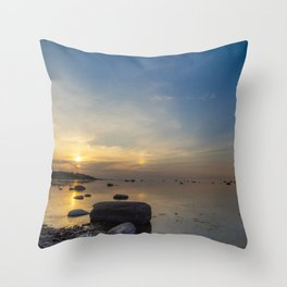 Sun with faint halo over the calm sea and reef rocks Throw Pillow