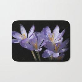 lilac crocusses on black Bath Mat