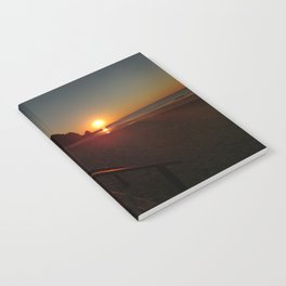 Shack by the sea at sunrise Notebook