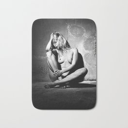 Lonely Beauty - Nude woman alone in a dungeon or cellar Bath Mat