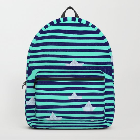 Origami boat on the blue sea Backpack