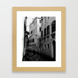 Venetian canal in black and white Framed Art Print