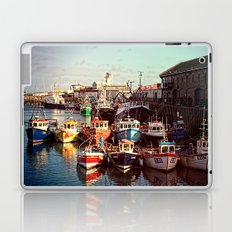 Boats resting in the Harbour Laptop & iPad Skin