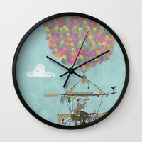 brompton Wall Clocks featuring Riding A Bicycle Through The Mountains by Wyatt Design
