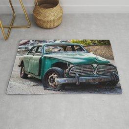 Smashed vintage car Rug