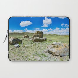 Tarkhatinsky megalithic complex. Steppe and blue mountains on the horizon. Altai Russia. Laptop Sleeve