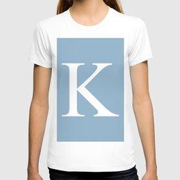 Letter K sign on placid blue background T-shirt