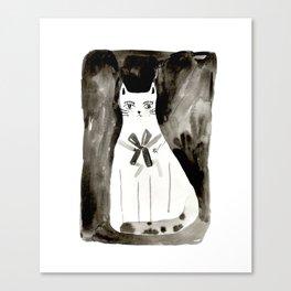 a cat sits Canvas Print