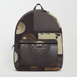 Music. Vintage wall with vinyl records and audio cassettes hung. Backpack
