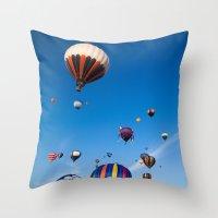 hot air balloons Throw Pillows featuring Vibrant Hot Air Balloons by Nicolas Raymond