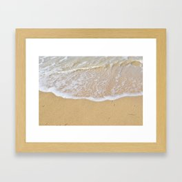 Beautiful wave surfing on a sandy beach Framed Art Print