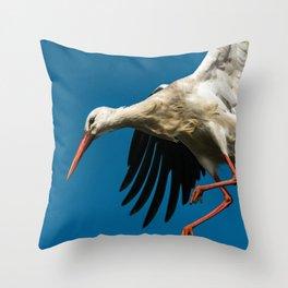 white stork landing on nest Throw Pillow