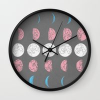 moon phase Wall Clocks featuring Not Just A Phase by August