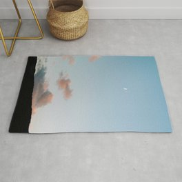 Pastel moody sunset clouds with a small moon  Rug