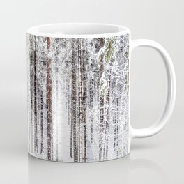 A snow covered forest Coffee Mug