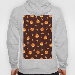 Orange pumpkin scary faces and candy halloween hand drawn illustration pattern on dark background Hoody